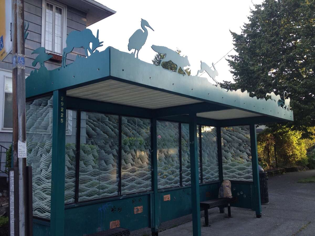 King County Metro has a bus shelter arts program to involve youth and community members in sprucing up bus shelters. Here, it's the steel menagerie atop this Metro shelter at North 46th Street and Phinney Avenue North. Called