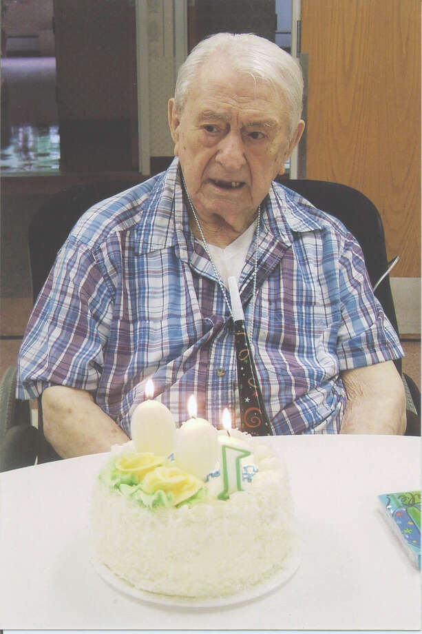 """Alfred """"Fred"""" Farina enjoys a recent party celebrating his 100th birthday at Fairfield's Cambridge Manor. He owned Farina's Texaco Service Station for four decades until the mid-1980s. Photo: Contributed Photo"""