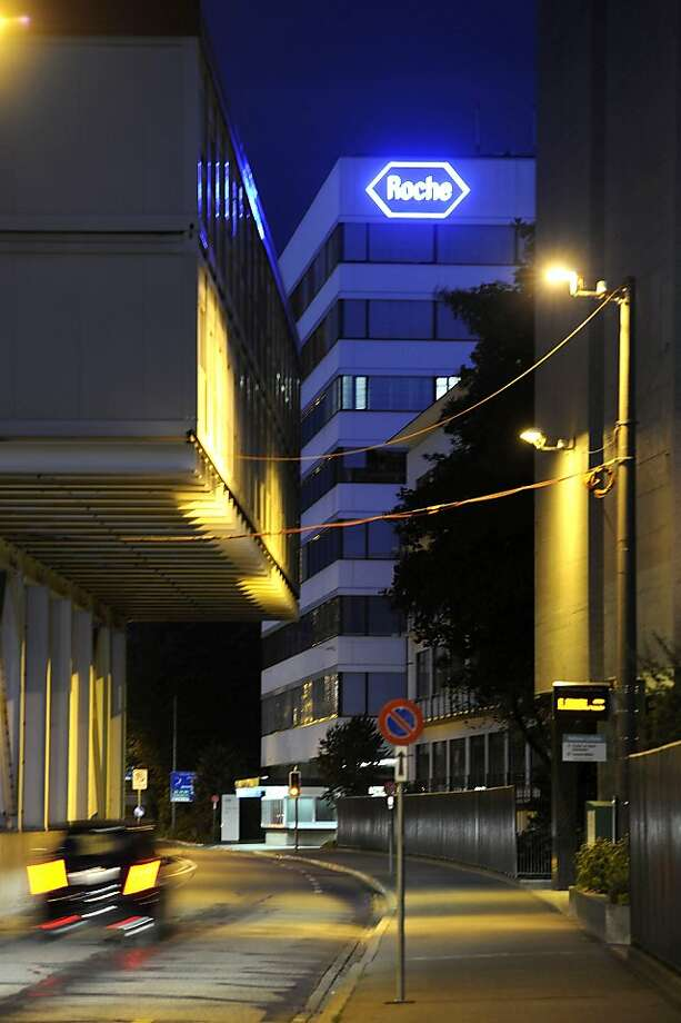A Roche Holding AG plant is seen by street light in Basel, Switzerland, on Wednesday, July 21, 2010. Roche Holding AG, the world's biggest maker of cancer drugs, reported a 58 percent increase in first-half profit, helped by lower costs associated with the integration of Genentech. Photographer: Giuseppe Aresu/Bloomberg Photo: Giuseppe Aresu, Bloomberg