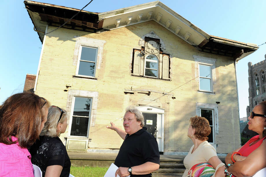 Developer Phil Kuchma talks about the former American Legion hall that he owns at 307 Golden Hill St., in Bridgeport, Conn. as he leads a walking tour of the area for city council members July 12th, 2012. Kuchma would like to swap the building to the city in exchange for other property nearby that he would like to develope. In turn, he would also turn the building into a new senior center. Photo: Ned Gerard / Connecticut Post