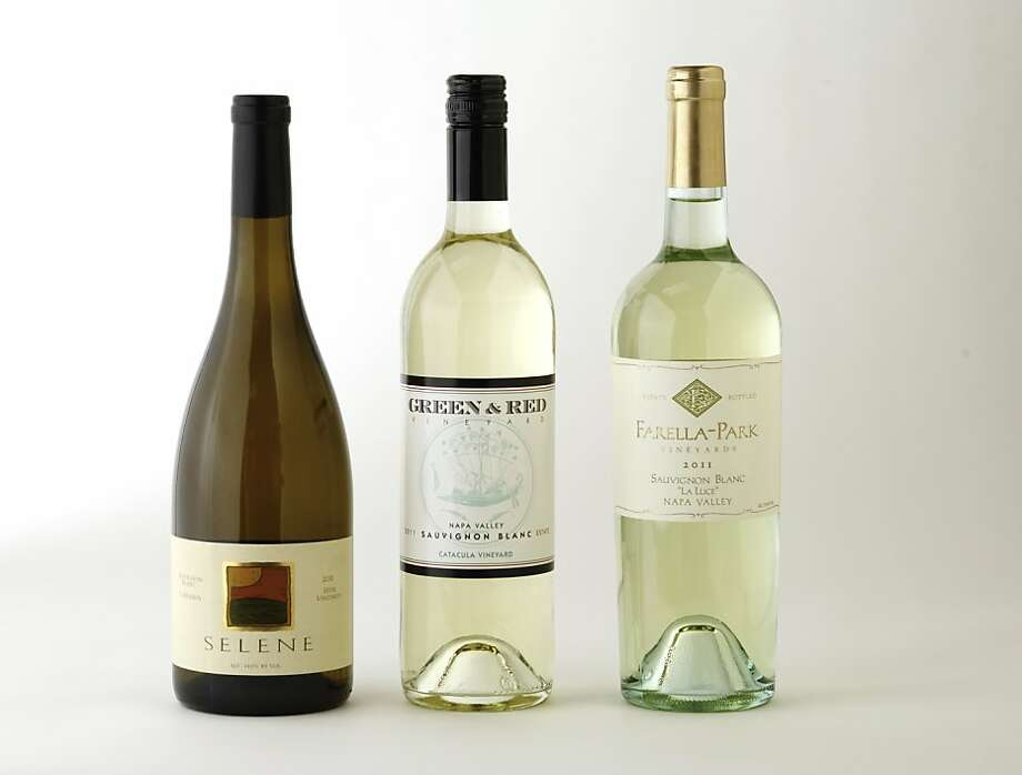 Three bottles of Napa Valley Sauvignon Blanc, left-right:  2011 Selene Hyde Vineyards Carneros Sauvignon Blanc; 2011 Green & Red Catacula Vineyard Napa Valley Sauvignon Blanc; 2011 Farella-Park La Luce Coombsville Sauvignon Blanc. Photo: Craig Lee, Special To The Chronicle