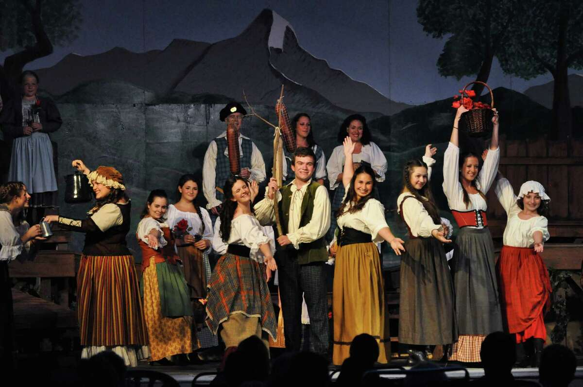"""MacConnachy Square comes to vibrant life as villagers gather at the start of """"Brigadoon,"""" playing outdoors at Musicals at Richter in Danbury."""