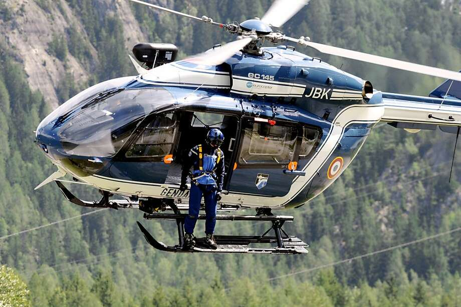 """A French Gendarmerie helicopter takes off to continue the research for other victims on July 12, 2012 in Chamonix, in the French Alps. The avalanche killed at least nine people and injured eight during the night in the Mont Maudit, a mountain in the Mont Blanc range. Local authorities said the avalanche was """"the most deadly of recent years"""".   AFP PHOTO JEAN-PIERRE CLATOTJEAN-PIERRE CLATOT/AFP/GettyImages Photo: Jean-pierre Clatot, AFP/Getty Images"""