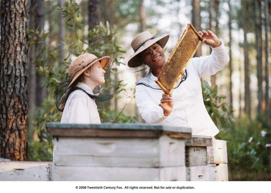 The Secret Life of Bees - L-R: Dakota Fanning and Queen Latifah / Photo Credit: Sidney Baldwin Photo: Sidney Baldwin / handout
