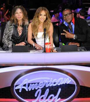 "In this Feb. 28, 2012 photo released by Fox, judges, from left,  Steven Tyler, Jennifer Lopez and Randy Jackson are shown on the set of the singing competition series, ""American Idol,"" in Los Angeles.  Tyler announced Thursday, July 12, 2012 that he will not be returning as a judge on the singing competition series ""American Idol."" Tyler served as a judge with singer/actress Jennifer Lopez and Randy Jackson on the 10th and 11th season of the series. Photo: AP"