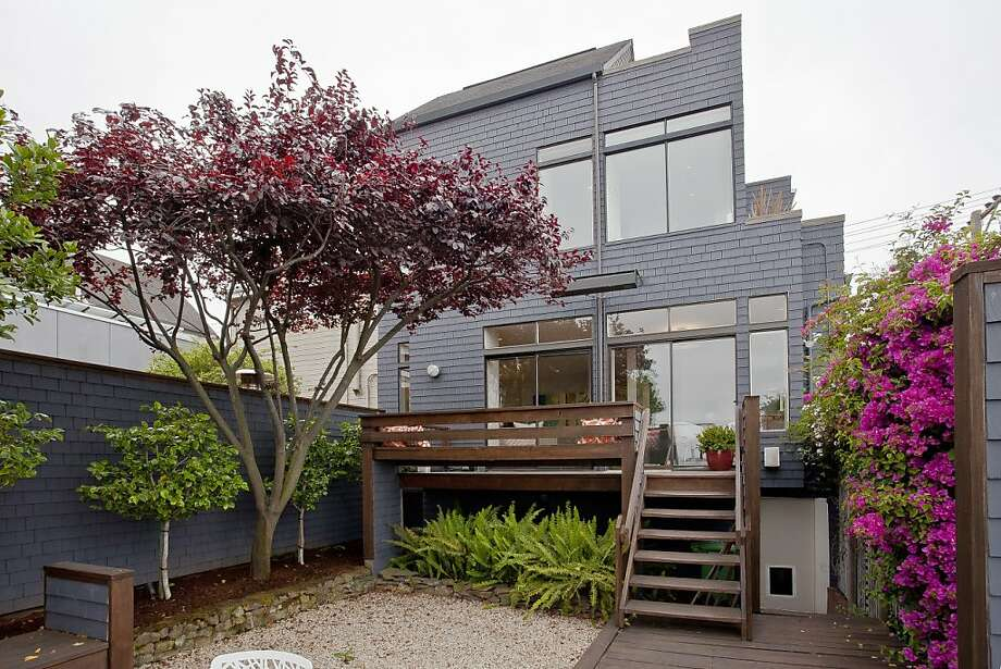 According to the listing agent, the garden allows the homeowners to enjoy seclusion from the hustle of the city, while its Potrero Hill location keeps its amenities within arm's reach. Photo: Open Homes Photography