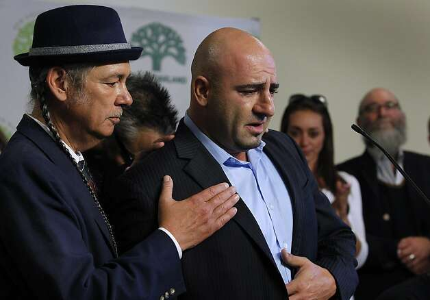Harborside Health Center co-founder Steve DeAngelo (left) comforts Jason David, who describes his 5-year-old son Jayden's battle with Dravet Syndrome, a rare form of epilepsy, and how medicinal marijuana he acquires from Harborside has helped Jayden deal with the disease. Local public officials and patients held a news conference in Oakland, Calif. on Thursday, July 12, 2012 to criticize the federal government's threat to seize assets and shut down the medical marijuana dispensary. Photo: Paul Chinn, The Chronicle