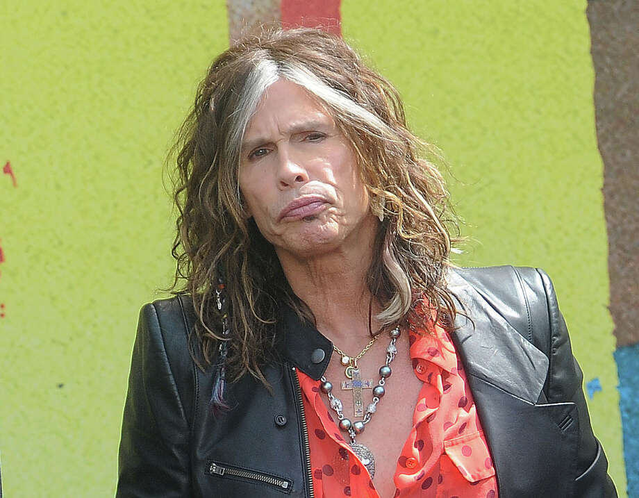 "FILE - This March 28, 2012 file photo shows Steven Tyler speaking at the Aerosmith news conference announcing the 2012 Global Warming Tour  in Los Angeles. Tyler announced Thursday, July 12, 2012 that he will not be returning as a judge on the singing competition series ""American Idol."" Tyler served as a judge with singer/actress Jennifer Lopez and Randy Jackson on the 10th and 11th season of the series. (AP Photo/Katy Winn, file) Photo: Katy Winn / AP2012"