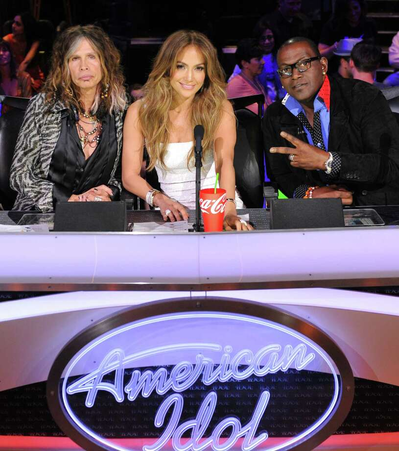 "In this Feb. 28, 2012 photo released by Fox, judges, from left,  Steven Tyler, Jennifer Lopez and Randy Jackson are shown on the set of the singing competition series, ""American Idol,"" in Los Angeles.  Tyler announced Thursday, July 12, 2012 that he will not be returning as a judge on the singing competition series ""American Idol."" Tyler served as a judge with singer/actress Jennifer Lopez and Randy Jackson on the 10th and 11th season of the series. (AP Photo/Fox, Michael Becker, file) Photo: Michael Becker / AP2012"