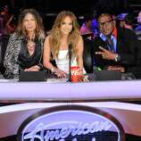 """In this Feb. 28, 2012 photo released by Fox, judges, from left,  Steven Tyler, Jennifer Lopez and Randy Jackson are shown on the set of the singing competition series, """"American Idol,"""" in Los Angeles.  Tyler announced Thursday, July 12, 2012 that he will not be returning as a judge on the singing competition series """"American Idol."""" Tyler served as a judge with singer/actress Jennifer Lopez and Randy Jackson on the 10th and 11th season of the series. (AP Photo/Fox, Michael Becker, file)"""