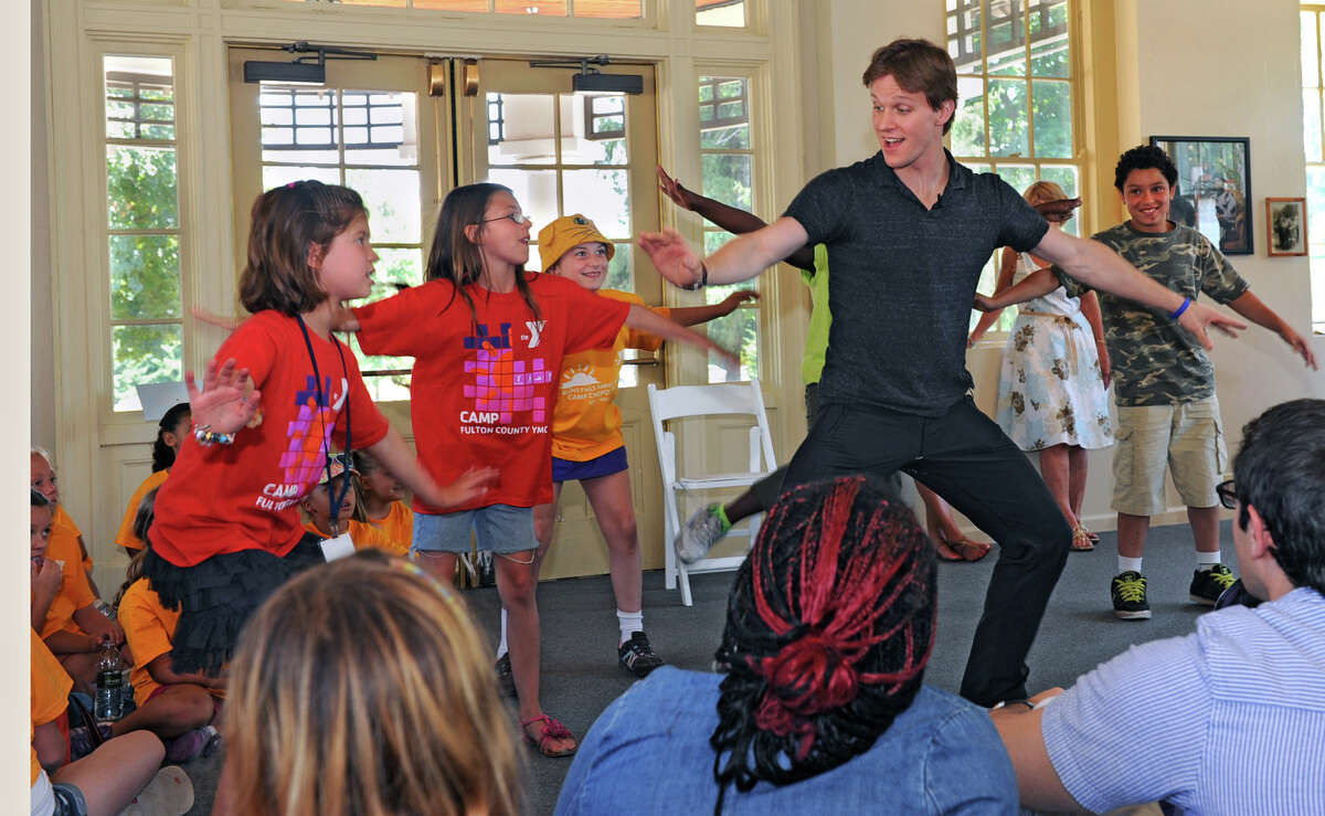 Daniel Ulbricht, the principal dancer for the New York City Ballet, meets with 200 children from youth groups around the region and teaches some techniques at the Museum of Dance Thursday, July 12, 2012 in Saratoga Springs, N.Y. (Lori Van Buren / Times Union)