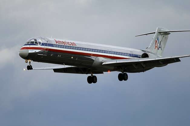 FILE- In this Oct. 29, 2010 file photo, an American Airlines jet airplane approaches Philadelphia International Airport in Philadelphia. American Airlines is weighing various merger options, but most analysts say the nation's No. 3 airline only has one viable choice: partner with US Airways. American could leave bankruptcy protection as an independent. (AP Photo/Matt Rourke, File) Photo: Matt Rourke, Associated Press