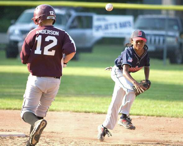 Danbury shortstop Javon Hernandez gets the force at second but his throw to first is too late to complete the double play against Bethel in the Cal Ripken 10-year-old state tournament championship game Thursday at Mitchell Park in Bethel. Photo: Barry Horn / The News-Times Freelance