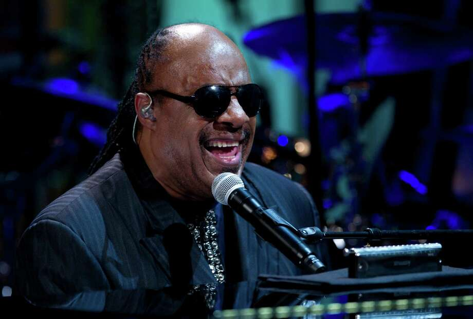 """FILE - In this May 9, 2012 file photo, Stevie Wonder performs during the """"In Performance at the White House"""" in the East Room of the White House in Washington, honoring songwriters Burt Bacharach and Hal David.  Authorities have charged two people, including a man who identifies as Wonder's nephew, with extortion for a plot in which they tried to trade what they said was embarrassing information in exchange for money. (AP Photo/Carolyn Kaster, File) Photo: Carolyn Kaster / AP2012"""