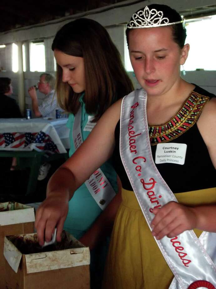 Rensselaer County Dairy Princess Courtney Luskin serves ice cream July 8 at a picnic hosted by the Agricultural Stewardship Association, a community-supported land trust dedicated to protecting local farmland from encroaching development. (Submitted photo)