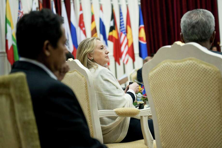 U.S. Secretary of State Hillary Rodham Clinton listens to a speech delivered by a delegation member during the ASEAN Regional forum at the Peace Palace in Phnom Penh, Cambodia, Thursday, July 12, 2012. (AP Photo/Brendon Smialowski, Pool) Photo: Brendan Smialowski