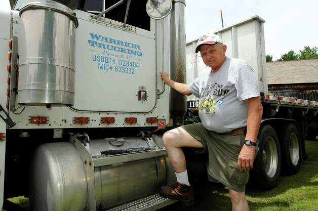Ed Quackenbush, owner and operator of Warrior Trucking, with his semi-truck on Saturday, June 30, 2012, at his home in Stillwater, N.Y. (Cindy Schultz / Times Union) Photo: Cindy Schultz / 00018272A