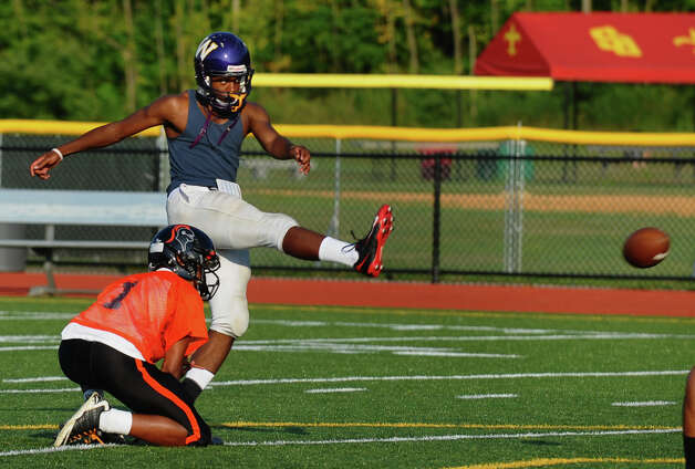 Westhill Dylan Moye kicks the ball, during Fairfield County All-Star football practice at St. Joseph High School in Trumbull, Conn. on Thursday July 12, 2012. Photo: Christian Abraham / Connecticut Post