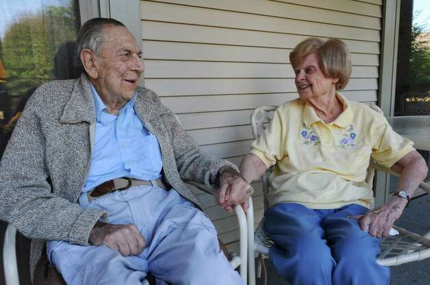 "Bob Herman, 92, and his wife of 70 years, Bea, talk about ""The Last Leaf,"" a collection of poetry by him that will soon be published, at their home on Wednesday  July 11, 2012 in Slingerlands, NY. (Philip Kamrass / Times Union) Photo: Philip Kamrass / 00018419A"