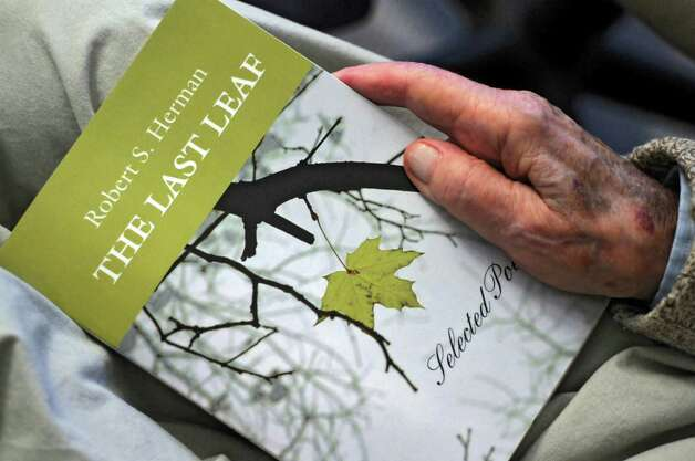 "Bob Herman, 92, holds a copy of ""The Last Leaf,"" a collection of poetry by him that will soon be published, in his home on Wednesday  July 11, 2012 in Slingerlands, NY. (Philip Kamrass / Times Union) Photo: Philip Kamrass / 00018419A"