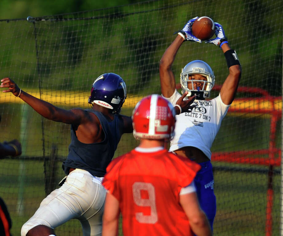 Bunnell's Jawad Chisholm catches a pass during Fairfield County's All-Star football practice at St. Joseph High School in Trumbull on Thursday July 12, 2012. Photo: Christian Abraham / Connecticut Post