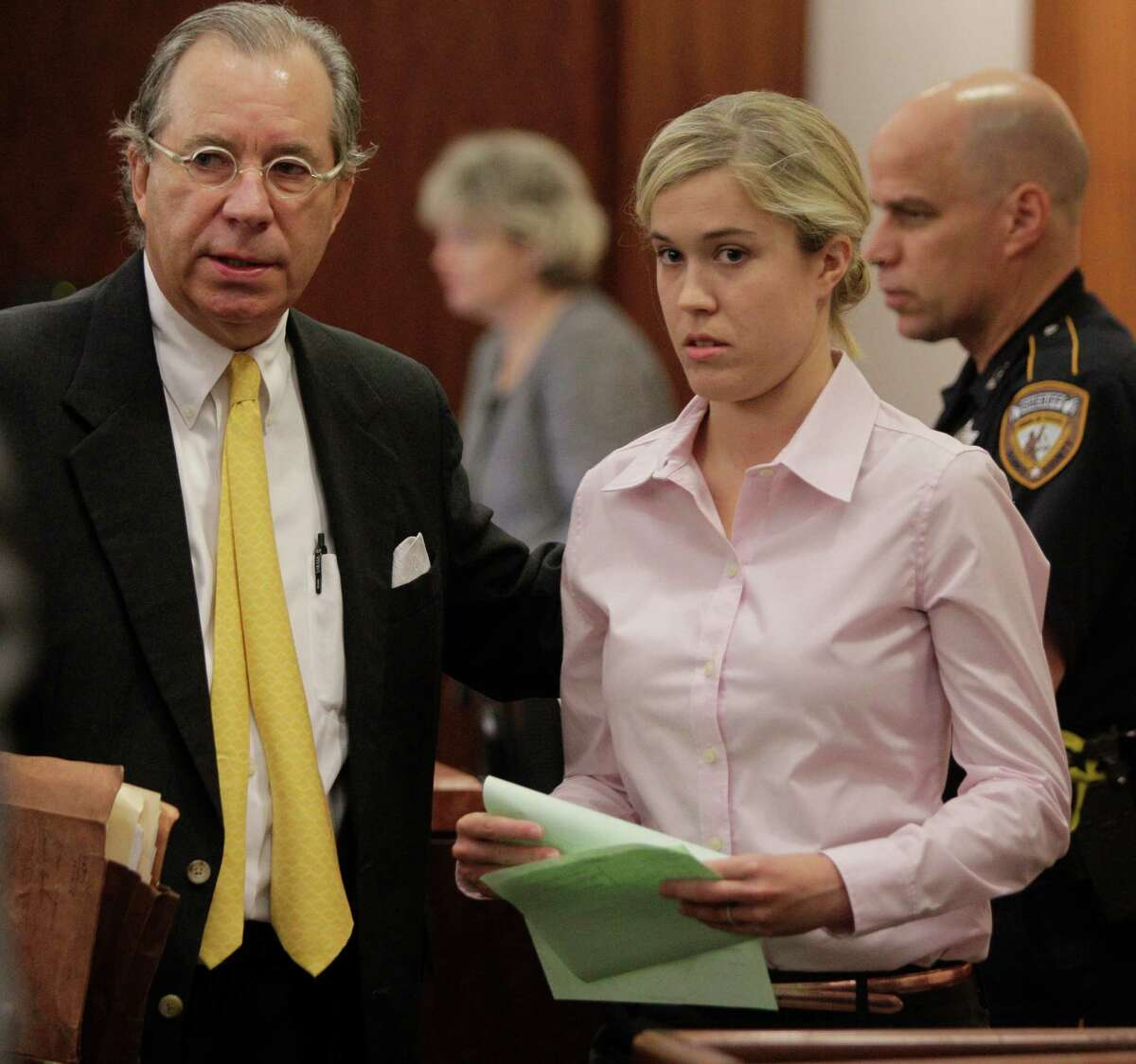 Kathryn Camille Murray, a former Spring Branch teacher accused of having sex with a 15-year-old student, leaves courtroom with attorney Robert Ross, right, at the Harris County Criminal Justice Center, 1201 Franklin, Thursday, July 12, 2012, in Houston. ( Melissa Phillip / Houston Chronicle )