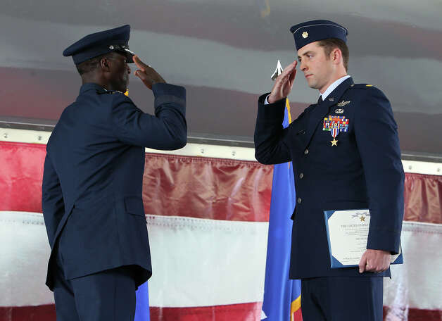 Air Force Major Joshua M. Hallada (right) salutes Gen. Edward A. Rice, Jr., head of Air Education and Training Command, after being recognized with a Silver Star medal and citation at Randolph Air Force Base on Thursday, July 12, 2012. Hallada, 31, was awarded for his bravery and efforts in extracting two downed U.S. Army pilots as part of the 83rd Expeditionary Rescue Squadron located at Bagram Air Base in Afghanistan in April, 2011. The Silver Star is the third highest award for combat military decoration. The service crosses are ranked second highest and the Medal of Honor is the first highest in awards for the military. Photo: Kin Man Hui, SAN ANTONIO EXPRESS-NEWS / ©2012 SAN ANTONIO EXPRESS-NEWS
