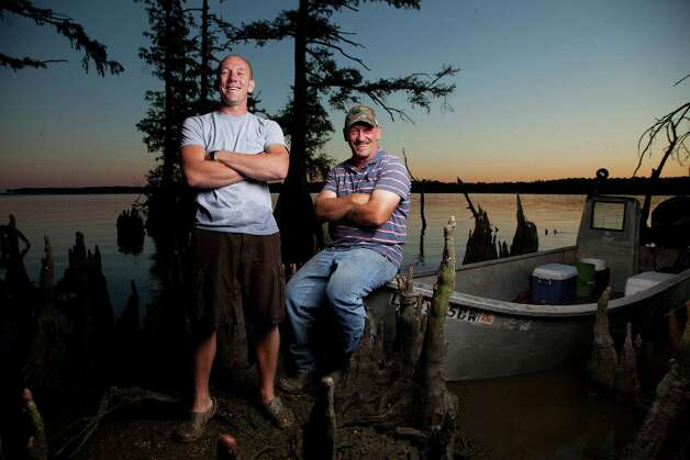"Troy and Jacob Landry, the gator-hunting, father-son duo in the History Channel's hit reality TV show ""Swamp People,"" will appear and sign autographs at the new Baskins in Alexandria on Saturday, April 7. (PRNewsFoto/Baskins) Photo: AP, HO / AP2012"