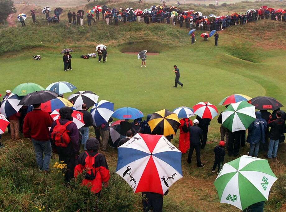Nick Faldo arrives on the second green of the Royal Birkdale, Friday, July 17, 1998, on the second day of the British Open, which has been struck by bad weather.  The conditions on the course were in complete contrast to the opening day which saw play in hot and sunny conditions. (AP Photo/ Rebecca Naden) Photo: REBECCA NADEN / PA