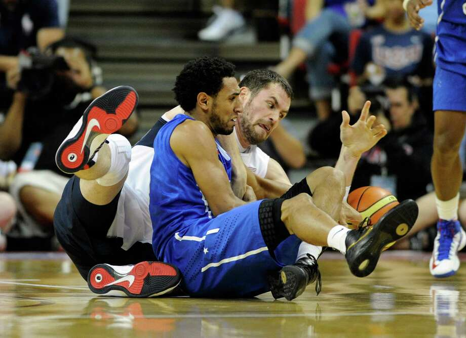 LAS VEGAS, NV - JULY 12: Kevin Love #11 of the US Men's Senior National Team and Edgar Sosa #4 of the Dominican Republic scramble for a loose ball during a pre-Olympic exhibition game at Thomas & Mack Center on July 12, 2012 in Las Vegas, Nevada. Photo: David Becker, Getty Images / 2012 Getty Images