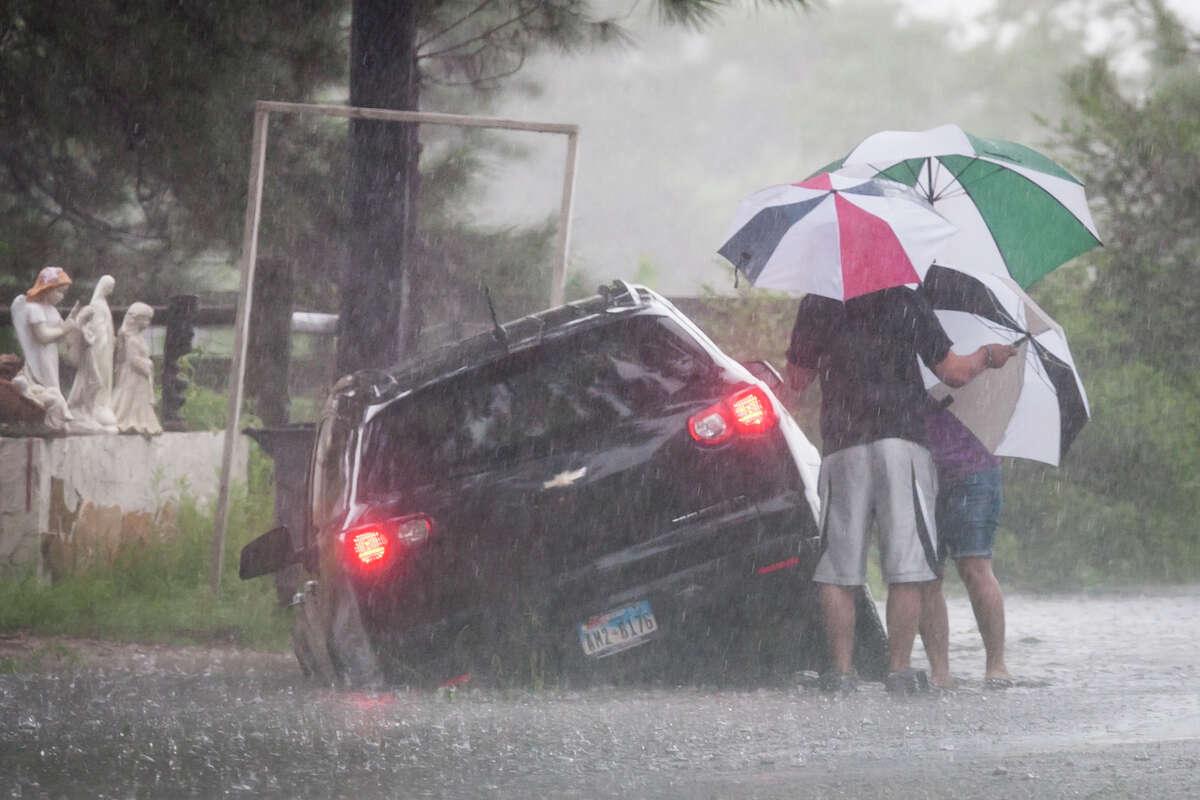 Raymond Valenta and his mother, Koran Kaptchinskie, were stranded Thursday in high water on Telge in northwest Houston.