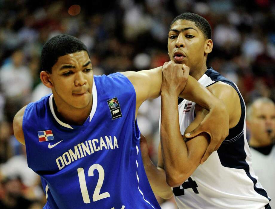 LAS VEGAS, NV - JULY 12:  Karl Towns #12 (L) of the Dominican Republic and Anthony Davis #14 of the US Men's Senior National Team tussle for a rebound during a pre-Olympic exhibition game at Thomas & Mack Center on July 12, 2012 in Las Vegas, Nevada. Davis was a last minute replacement for injured Blake Griffin. Photo: David Becker, Getty Images / 2012 Getty Images