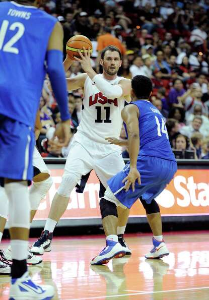 LAS VEGAS, NV - JULY 12:  Kevin Love #11 of the US Men's Senior National Team looks for an open team