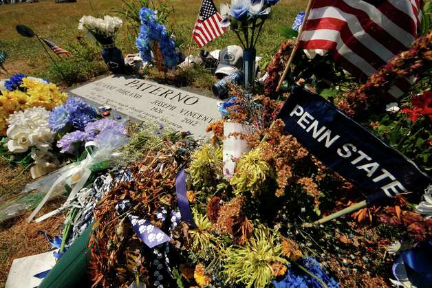 Items left by visitors surround the gravestone of former Penn State football coach Joe Paterno at the Spring Creek Presbyterian Cemetery in State College, Pa., Thursday, July 12, 2012. After an eight-month inquiry, Former FBI director Louis Freeh's firm produced a 267-page report that concluded that Paterno and other top Penn State officials hushed up child sex abuse allegation against Jerry Sandusky more than a decade ago for fear of bad publicity, allowing Sandusky to prey on other youngsters. (AP Photo/Gene J. Puskar) (AP Photo/Gene J. Puskar) Photo: Gene J. Puskar