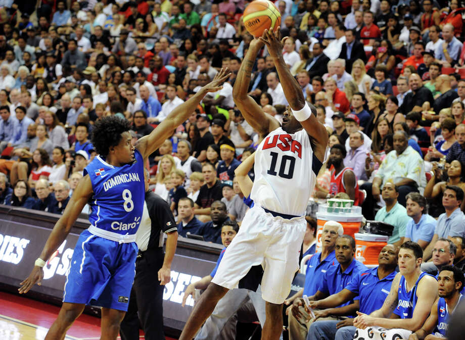 In this photo provided by the Las Vegas News Bureau, United States Olympic men's basketball team member Kobe Bryant (10) shoots a 3-pointer against the Dominican Republic during an exhibition game, Thursday, July 12, 2012, in Las Vegas. The U.S. won 113-59. (AP Photo/Las Vegas News Bureau, Brian Jones) Photo: Brian Jones, Associated Press / Las Vegas News Bureau