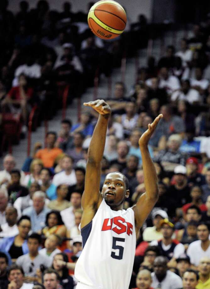 LAS VEGAS, NV - JULY 12:  Kevin Durant #5 of the US Men's Senior National Team shoots the ball during a pre-Olympic exhibition game against the Dominican Republic at Thomas & Mack Center on July 12, 2012 in Las Vegas, Nevada. The United States won the game 113-59. Photo: David Becker, Getty Images / 2012 Getty Images