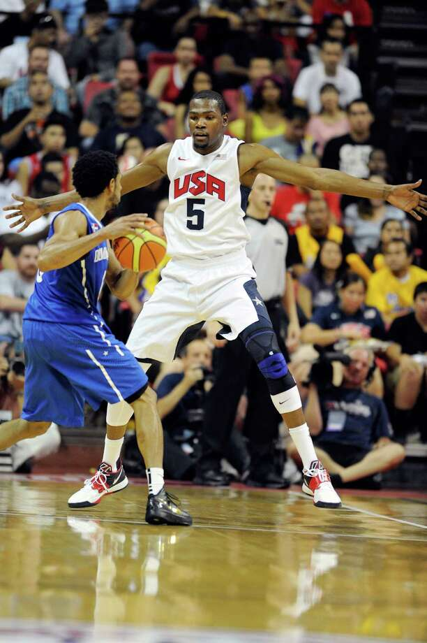 LAS VEGAS, NV - JULY 12:  Kevin Durant #5 of the US Men's Senior National Team guards against Juan Coronado Gill #6 of the Dominican Republic during a pre-Olympic exhibition game at Thomas & Mack Center on July 12, 2012 in Las Vegas, Nevada. The United States won the game 113-59. Photo: David Becker, Getty Images / 2012 Getty Images