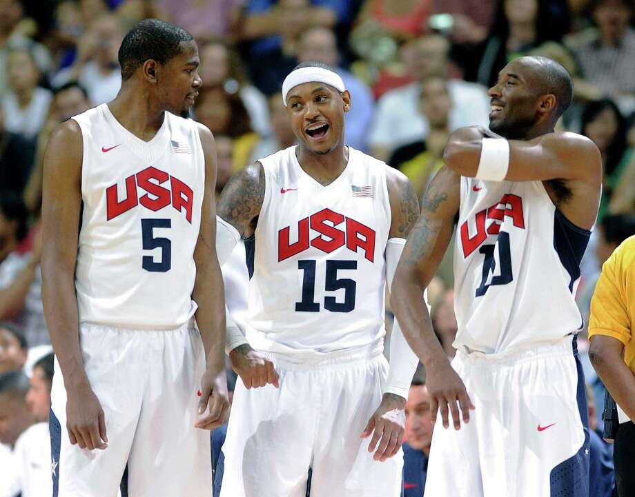 LAS VEGAS, NV - JULY 12:  (L-R) Kevin Durant #5, Carmelo Anthony #15 and Kobe Bryant #10 of the US Men's Senior National Team chat on the sideline during a timeout at a pre-Olympic exhibition game against the Dominican Republic at Thomas & Mack Center on July 12, 2012 in Las Vegas, Nevada. The United States won the game 113-59. Photo: David Becker, Getty Images / 2012 Getty Images