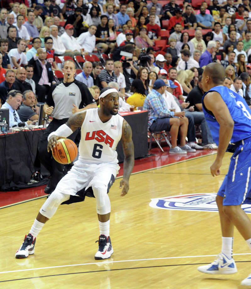In this photo provided by the Las Vegas News Bureau, U.S. Olympic men's basketball team member LeBron James looks to pass against the Dominican Republic during an exhibition game in Las Vegas on Thursday, July 12, 2012. The United States won 113-59. (AP Photo/Las Vegas News Bureau, Brian Jones) Photo: Brian Jones, Associated Press / Las Vegas News Bureau