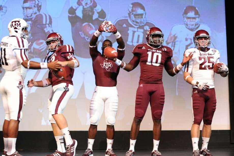 Linebacker Jonathan Stewart, linebacker Caleb Russell, running back Christine Michael, linebacker Sean Porter, a Clemens grad, and wide receiver Ryan Swope show off Texas A&M's new Adidas TECHFIT football uniforms in College Station on Thursday, July 12, 2012. (Texas A&M University)
