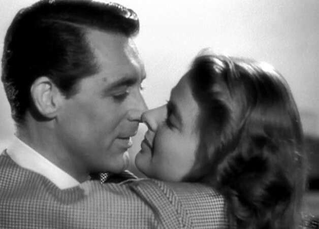 Cary Grant and Ingrid Bergman in the extended kissing scene from NOTORIOUS.