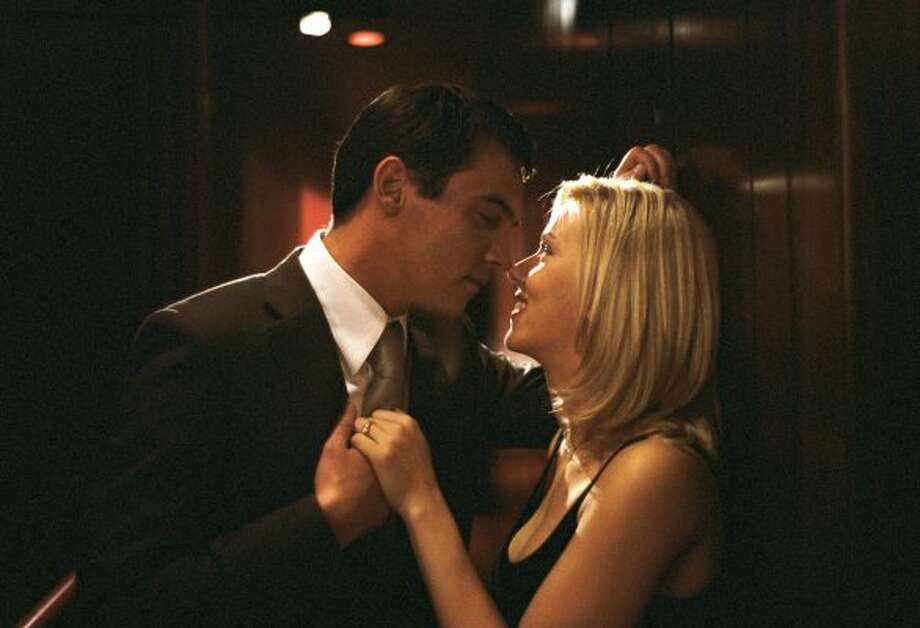 "Jonathan Rhys Meyers and Scarlett Johansson in Woody Allen's ""Match Point.""  (Clive Coote / DreamWorks)"