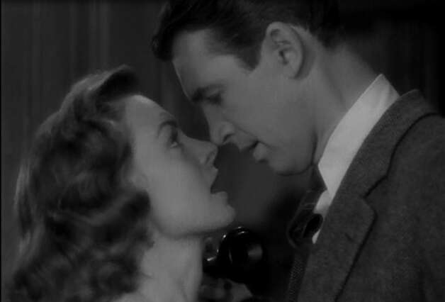 "James Stewart and Donna Reed, no longer able to deny it or put it off in ""IT'S A WONDERFUL LIFE."""