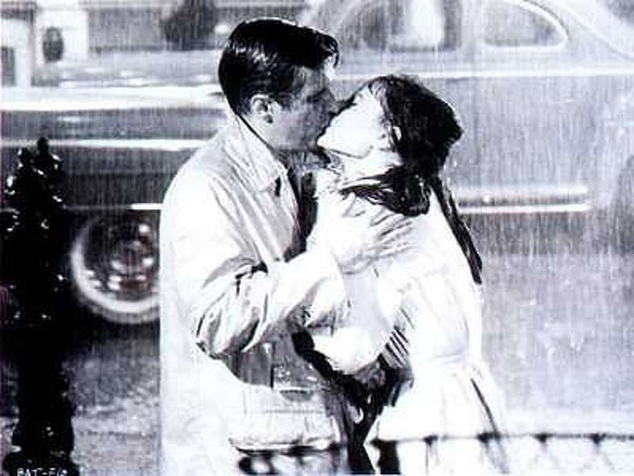 "George Peppard and Audrey Hepburn in the last scene of ""Breakfast at Tiffany's."" (Paramount Pictures 1961)"