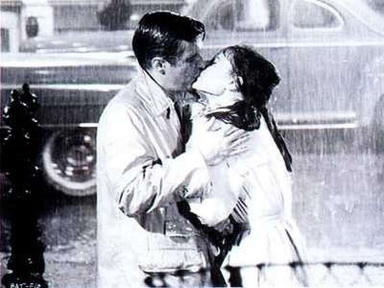 George Peppard and Audrey Hepburn in the last scene of