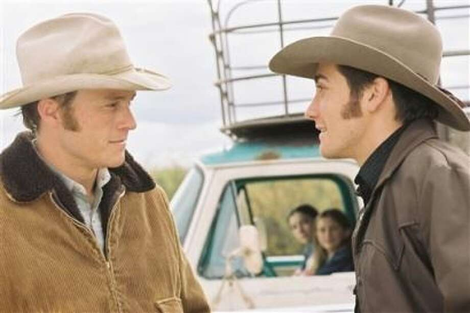 """Brokeback Mountain"" -- breakthrough film from 2005.  The famous kissing scene comes after an early renunion and is witnessed by the wife of one of the men (played by Michelle Williams)."
