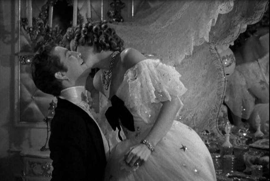 """Camille"":  Garbo surprises Robert Taylor by kissing him all over his face, in this classic scene from the 1937 film."