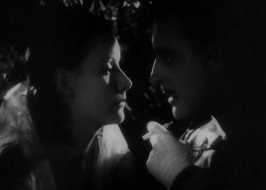 """The classic seduction scene from """"Flesh and the Devil"""" -- hot stuff in 1927 and not exactly cold stuff today."""