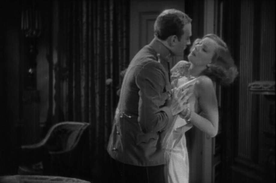 The Mysterious Lady (1928):  Garbo brings home a young officer, and THIS is what happens.