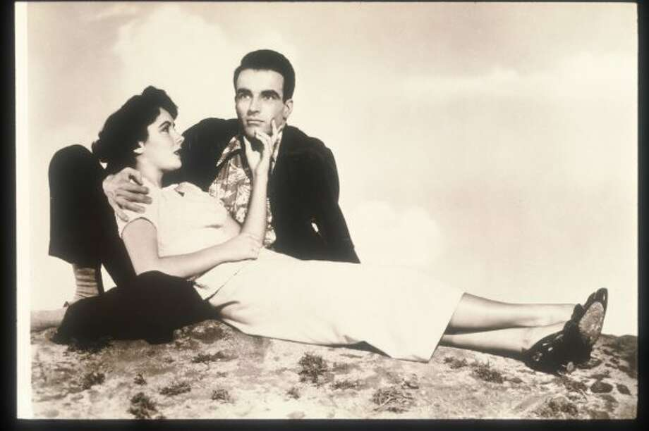 "Elizabeth taylor and Montgomery Clift in A PLACE IN THE SUN, famous for the ""tell Mama"" scene. (Getty Images)"